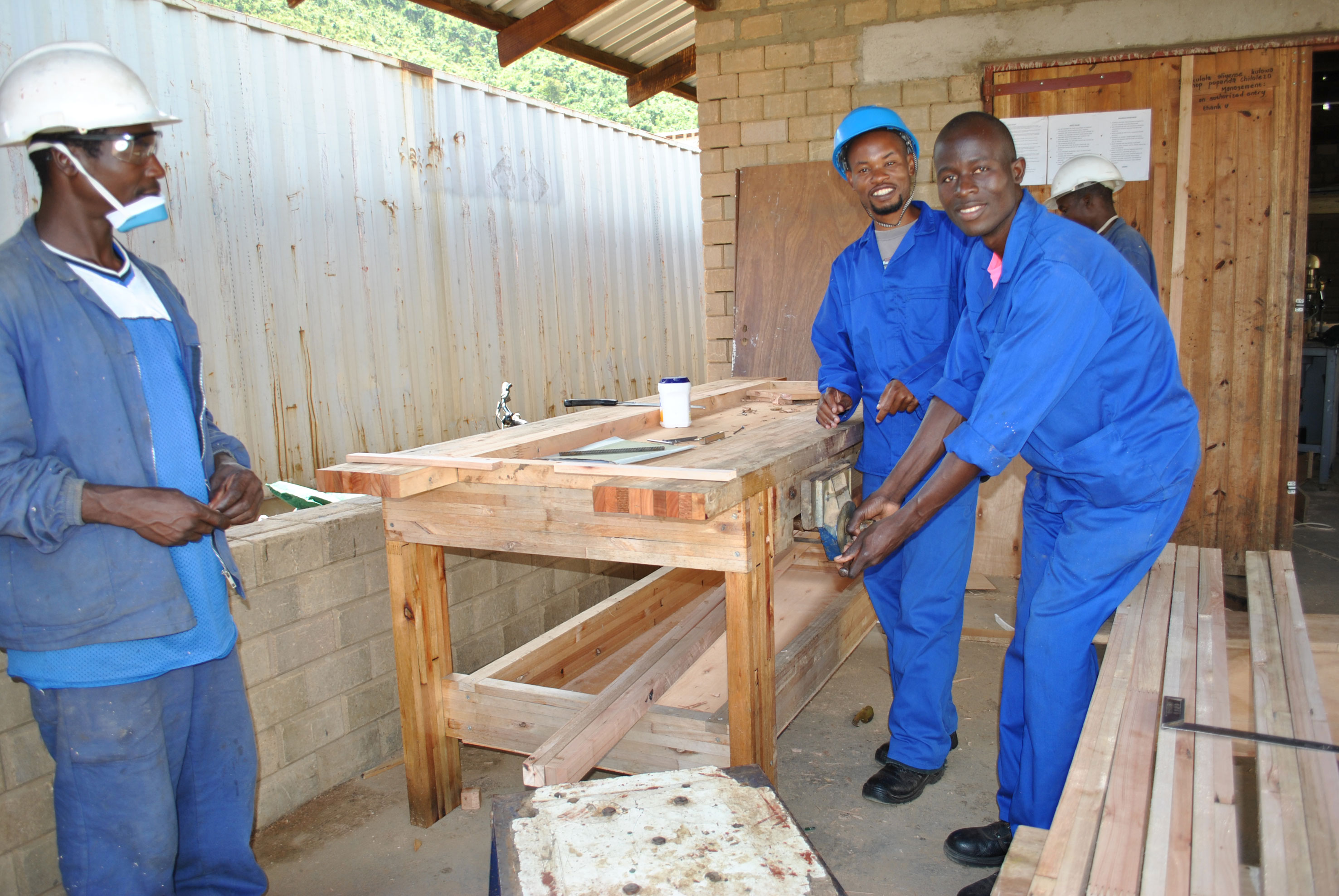 Carpenters show off their handmade workbench