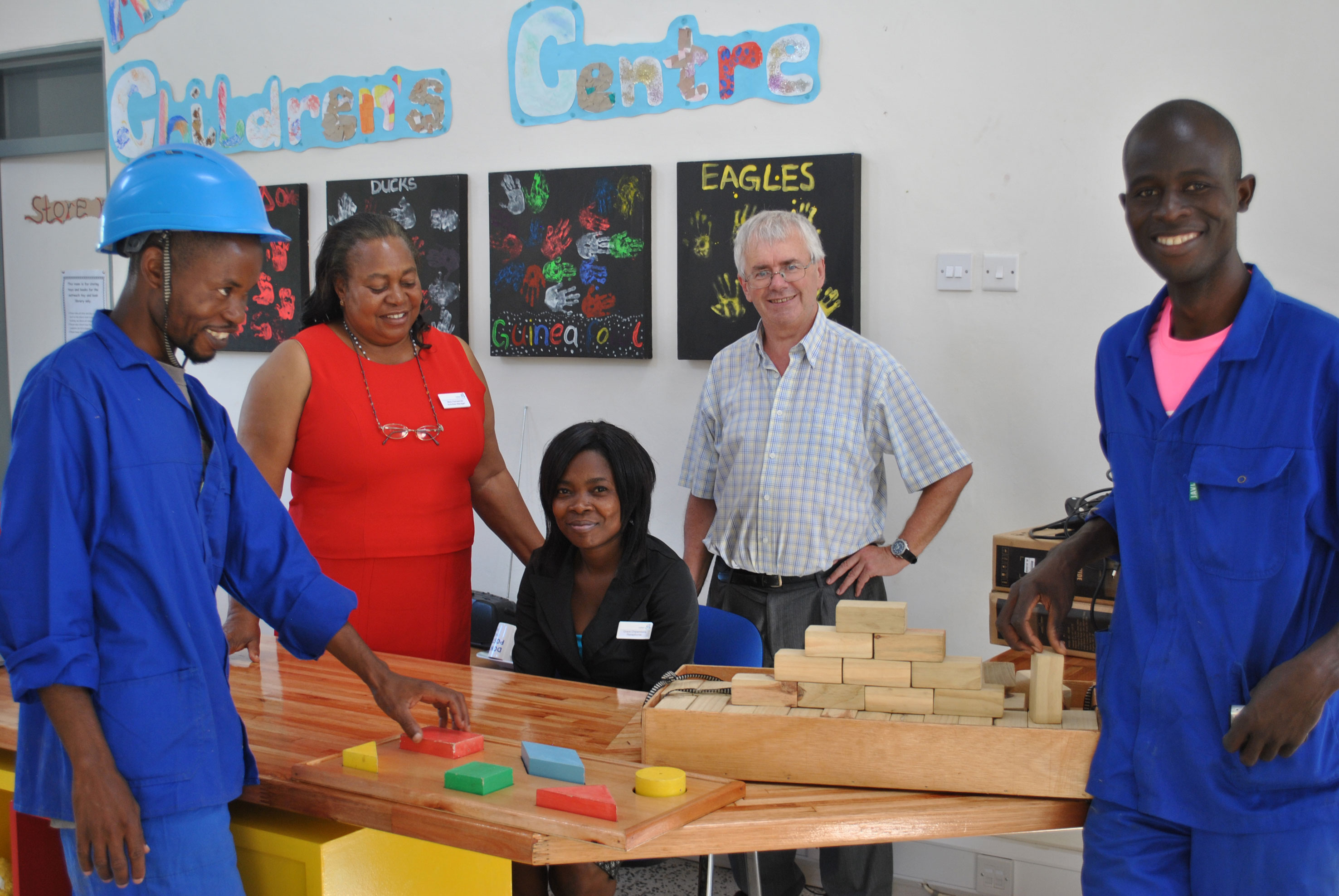 The carpenters present their hand made toys to the children's centre
