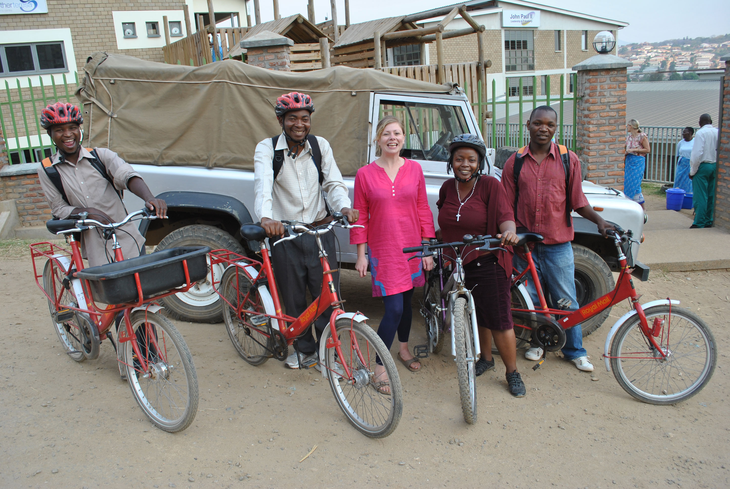 The Family Support team, visit local families on Royal Mail bikes