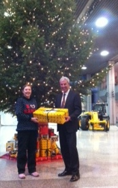 David Bell presents Zoe with the JCB gift to Malawi