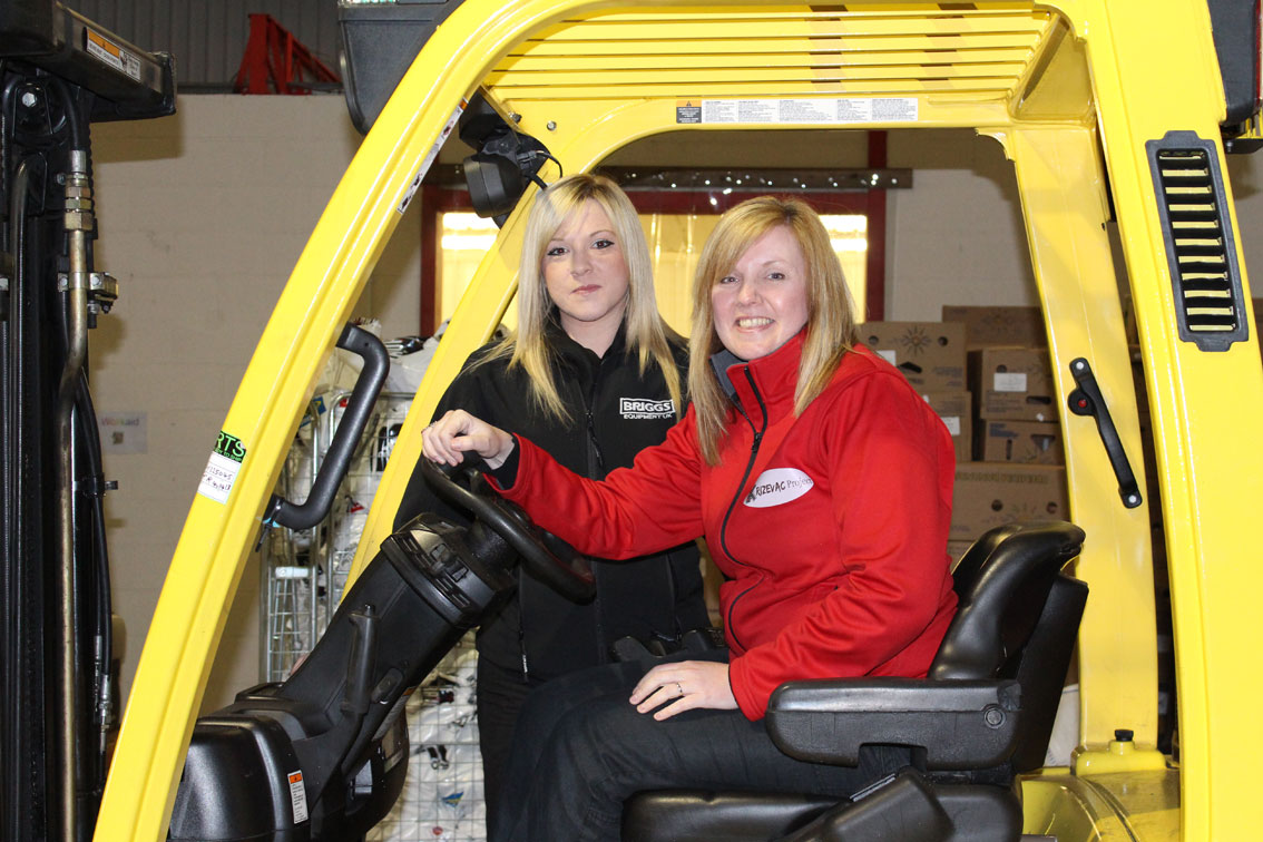 Zoe and Chloe checking out the labour saving fork lift truck at Krizevac's Uttoxeter Warehouse